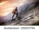 surfer on wave at sunset | Shutterstock . vector #250317781