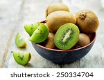 Kiwi On White Wood Background....