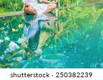 woman meditating at pool side.... | Shutterstock . vector #250382239