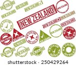 "Collection of 22 red grunge rubber stamps with text ""NEW ZEALAND"". Vector illustration"