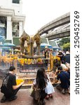 Small photo of BANGKOK THAILAND - 12 DEC 2014 : People pray at the shrine of the four-faced Brahma statue on December 12, 2014 at Ratchaprasong Junction in Bangkok,Thailand.