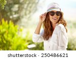 smiling summer woman with hat... | Shutterstock . vector #250486621