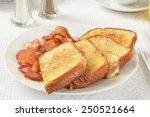 A Plate Of French Toast With...