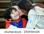 big sister kissing disabled... | Shutterstock . vector #250550104
