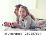 child playing video game on tv... | Shutterstock . vector #250657834
