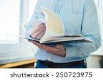 closeup on a man reading a...   Shutterstock . vector #250723975