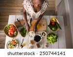 young african woman cooking.... | Shutterstock . vector #250744141