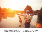 happy traveler on the lake with ... | Shutterstock . vector #250767229