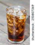 a glass of brown soda with ice... | Shutterstock . vector #250807369