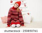 little girl in a red sweater | Shutterstock . vector #250850761