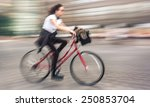 girl cyclist in traffic on the... | Shutterstock . vector #250853704