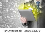 business man using tablet pc | Shutterstock . vector #250863379