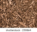 This is a sepia toned background photo of a pattern of wood chips. - stock photo