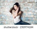sexy girl lying on dirty flore | Shutterstock . vector #250974184