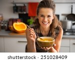happy young woman eating... | Shutterstock . vector #251028409