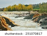 River Rapids Under Cloudy Sky