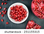red pomegranate seeds in a... | Shutterstock . vector #251155315