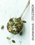 green pumpkin seeds on an old... | Shutterstock . vector #251228824