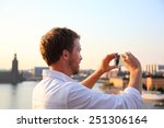 Tourist Taking Photograph Of...