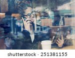 businesswomen using a mobile... | Shutterstock . vector #251381155