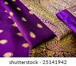 A Purple Saree Folded In Three...