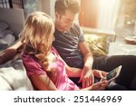 attractive couple using tablet... | Shutterstock . vector #251446969
