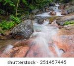 A Stream Rushes Through The...