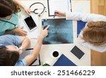 doctors sitting around the...   Shutterstock . vector #251466229