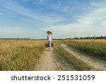 Small photo of Teenage traveler afoot on a country road