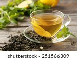 Stock photo cup with green tea on grey wooden background 251566309