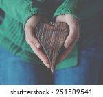 Hands Holding Wooden Heart