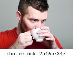 handsome sporty guy drinking... | Shutterstock . vector #251657347