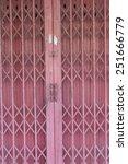 folding old red metal door gate | Shutterstock . vector #251666779