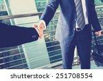 Handshake Of Businessman At Th...