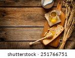 honey in a jar  slice of bread  ... | Shutterstock . vector #251766751