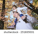 a family enjoying golden leaves ...   Shutterstock . vector #251835031