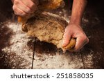 Baker Hands With Fresh Bread O...