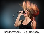 A Young Woman Rock Singer With...
