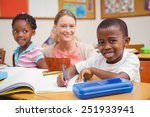 pretty teacher helping pupil in ... | Shutterstock . vector #251933941