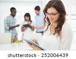 smiling businesswoman using... | Shutterstock . vector #252006439