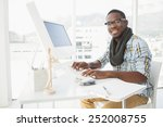 smiling businessman typing on... | Shutterstock . vector #252008755