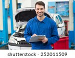 smiling mechanic looking at... | Shutterstock . vector #252011509