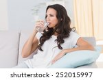 pretty brunette drinking water... | Shutterstock . vector #252015997