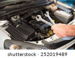 mechanic holding two types of... | Shutterstock . vector #252019489