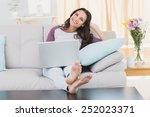 pretty brunette using her... | Shutterstock . vector #252023371