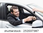 businessman sitting in drivers... | Shutterstock . vector #252037387