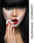 asian woman removing make up | Shutterstock . vector #252082357