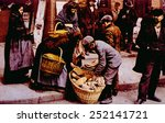 Italian immigrants selling bread on the streets of Manhattan, New York city, photochrom by William Henry Jackson, 1902