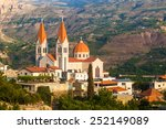 Small photo of Beautiful church in Bsharri city in Lebanon. Beautiful landscape. Travel to Lebanon. Qadisha valley.