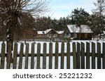 Small old village in west Poland, Koterka, wooden cottage by winter. Seasonal scenery. Farm in the snow. - stock photo